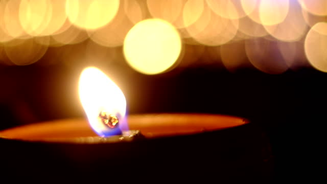 candles burning  in dark night with beautiful bokeh