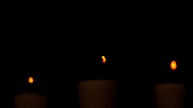 stockvideo's en b-roll-footage met candles dark to light - kandelaar