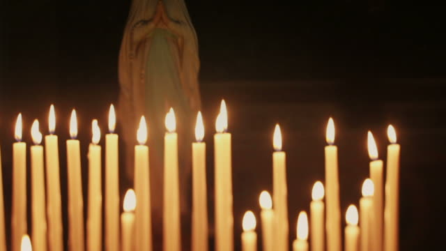 Candles in a church and the Virgin Mary video