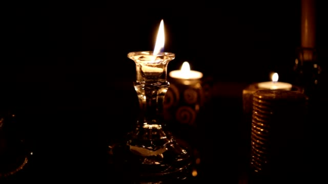 Candles in dark room video