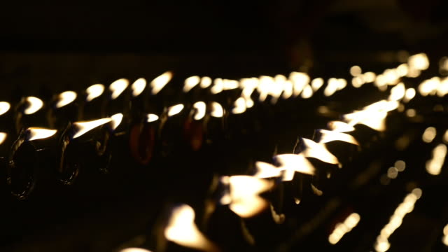 Candles in the Buddhist Temple A shot made by focusing on the candles in the Buddhist temple. focus on foreground stock videos & royalty-free footage