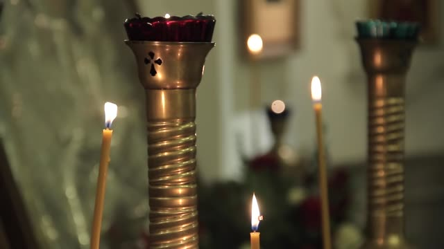 candles in the church - christening stock videos and b-roll footage