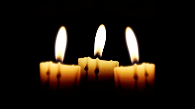 Candles in the night, close up, loop video