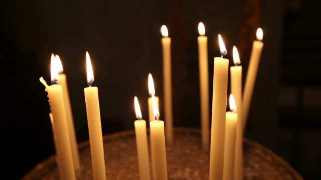 Candles inside a church in Rome video