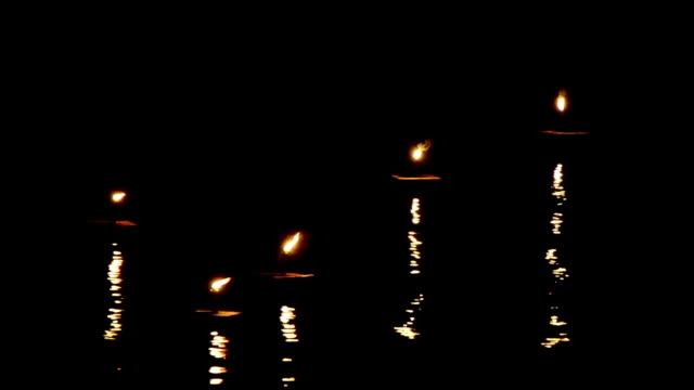Candles lights move and wave with nice reflection video