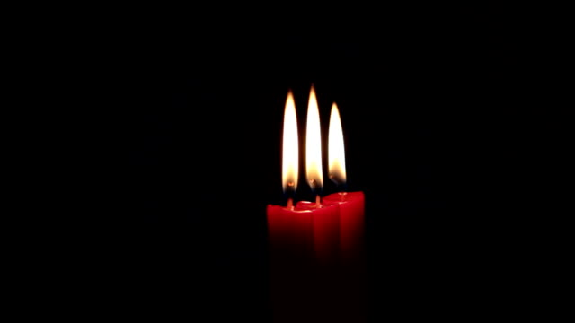 candles on black video