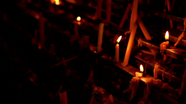 candles placed in a row. - gothic architecture stock videos & royalty-free footage