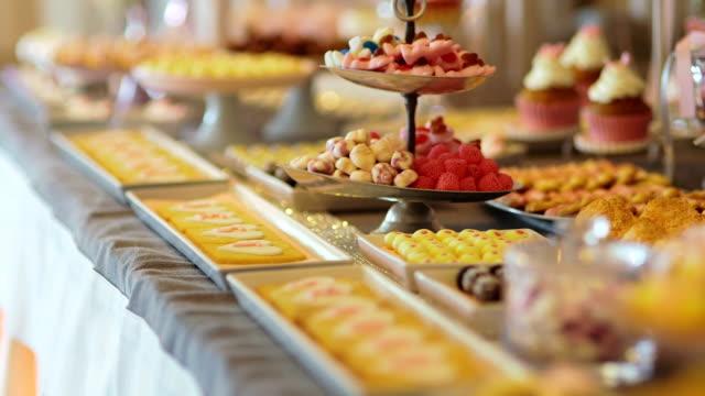 candy bar wedding, candy buffet, delicious candy bar at a wedding - buffet video stock e b–roll