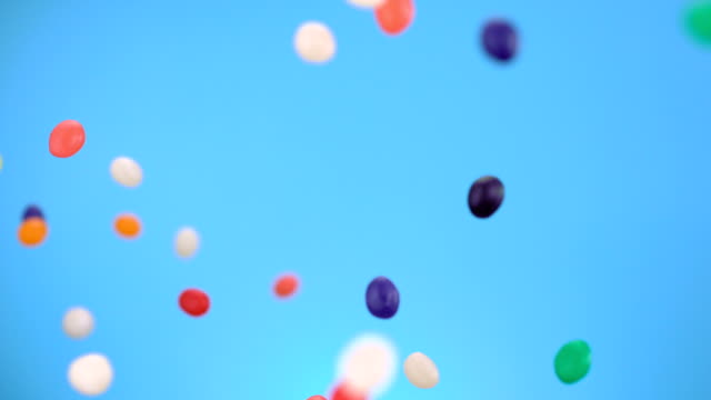 Candy, Slow Motion Colorful candy being thrown in the air shooting with high speed camera. candy stock videos & royalty-free footage