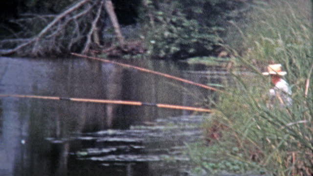 GALVESTON, TEXAS -1971: Cane fishing and catch with fish swim trap.