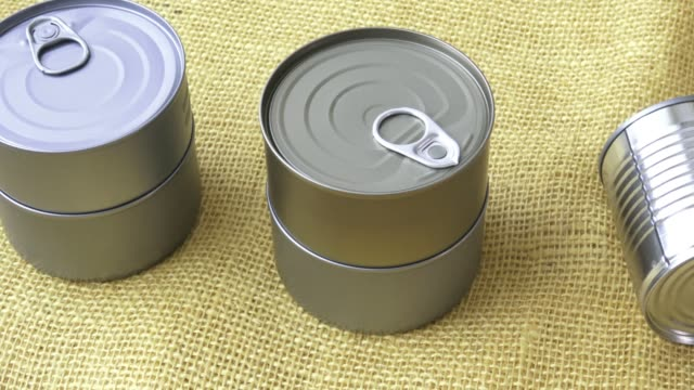 canned food in cans on the yellow jute - coperchio video stock e b–roll
