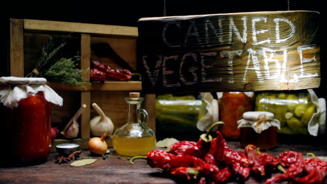 Canned shop lighting showcase Showcase of canned vegetable shop. Beamlight moving over wooden sign board. Variety of pickled vegetables on wooden counter pantry stock videos & royalty-free footage