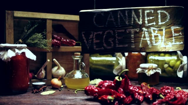 Canned vegetable store showcase Canned vegetable store showcase in traditional rustic style. Cans with pickles, spices and condiments under wood signboard 'Canned vegetable'. Light beam motion pantry stock videos & royalty-free footage