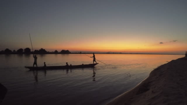 Canoe at sunset Young man stand up paddling, at sunset. Recorded by GoPro Hero 4. madagascar stock videos & royalty-free footage