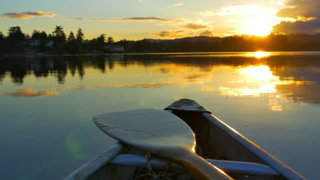 Canoe on Lake, Nature Adventure, Dusk Sunset on Still Ocean Water