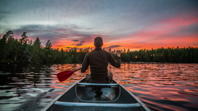 canoeing at sunrise - lakes stock videos and b-roll footage