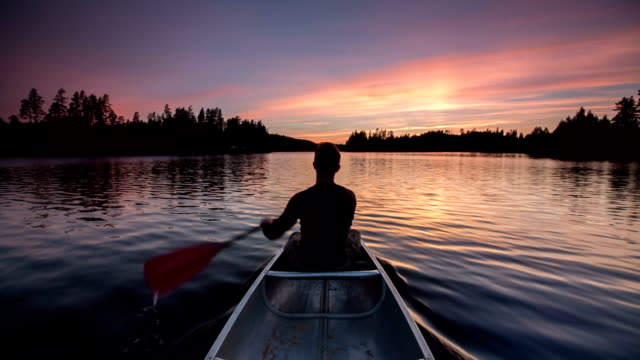 canoeing at sunset - lakes stock videos and b-roll footage