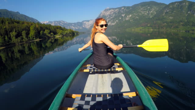 Canoeing on a lake in summer video