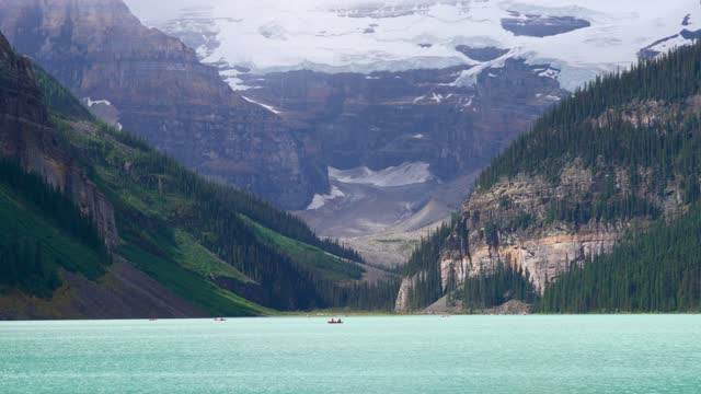 Canoeing on Lake Louise in sunmmer day