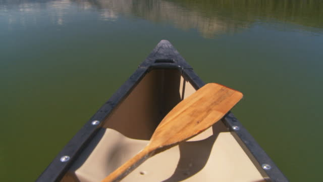 canoing on mountain lake video
