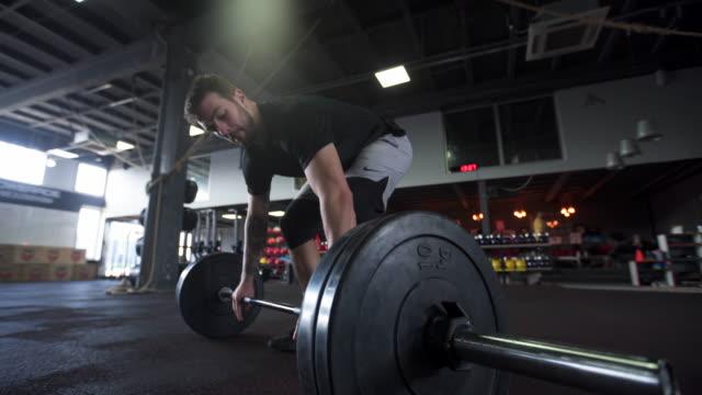 vídeos y material grabado en eventos de stock de no puedo ' no existe en mi vocabulario - entrenamiento con pesas