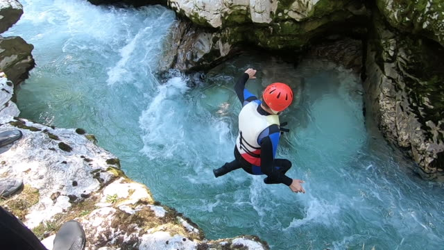 Canyoning Jump into blue river