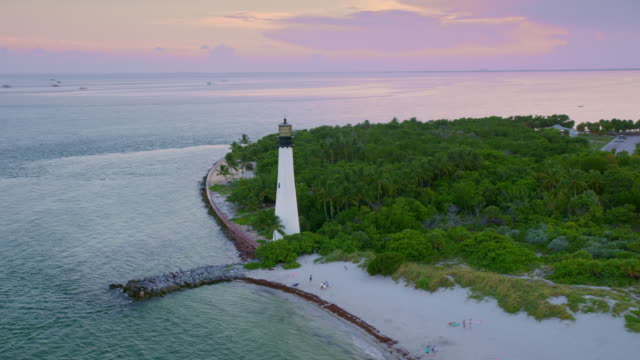 AERIAL Cape Florida Lighthouse, Key Biscayne, FL in setting sun