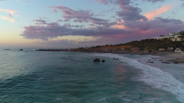 Cape Town Camps Bay Beach Aerial with Beautiful Pink Sunset over Rocks video