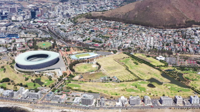 Cape Town South Africa Aerial View Sea Point Panorama Panning 4K Video Beautfiful Iconic Aerial Panorama 4K Drone Point of View Panning over the Coastal Cityscape of Cape Town in Summer with Clifton, Clifton Beach, Signal Hill and Cape Town Waterfront. Aerial Panorama 4K Video. Drone Point of View. Cape Town, Western Cape, South Africa, Africa western cape province stock videos & royalty-free footage