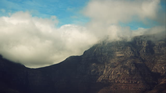 Capetown table mountain Handheld shot of the capetown table mountain on a summer day. Some clouds covering the top. cape peninsula stock videos & royalty-free footage