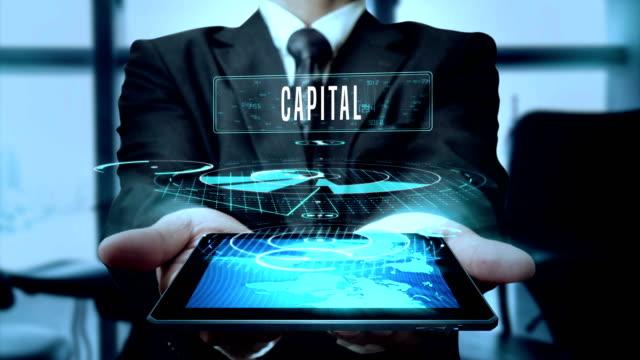 hauptstadt business investment milliardär konzept geschäftsmann mit hologramm tablet-technologie - schleife - billionär stock-videos und b-roll-filmmaterial