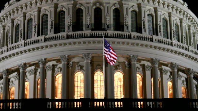 US Capitol Dome at Night in Washington DC - ECU An extreme close up of the US Capitol dome at night with American Flag waving in the breeze.  president stock videos & royalty-free footage