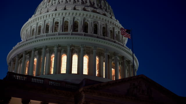 US Capitol Glowing American Flag Night video
