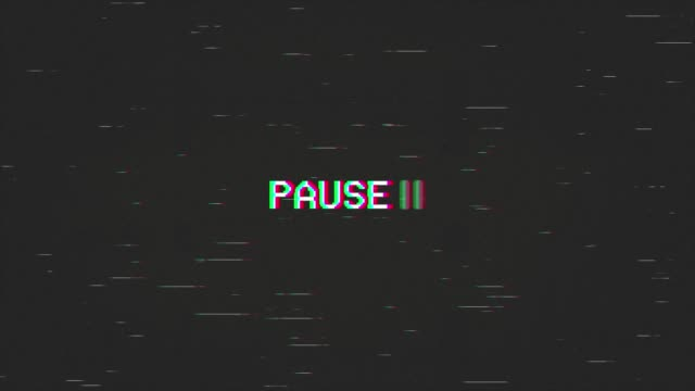 A capture of a VCR playing and pausing a VHS blank tape: the text Pause, appearing with a blinking symbol, at the center of the screen. Digital remake, regular size.