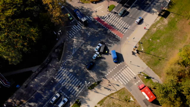 car accident scene (aerial view) crossroads with a car's accident in the urban settings car accident stock videos & royalty-free footage
