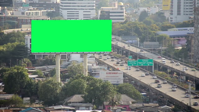 Car and traffic. Cars cruised the streets in the daytime shows traffic and billboards in green screen. billboard stock videos & royalty-free footage