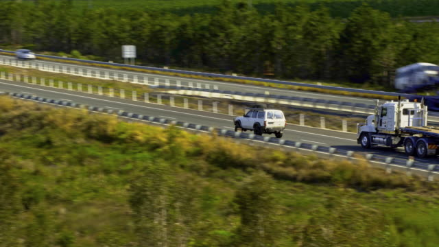Car and Truck travel on the highway through the mountains video