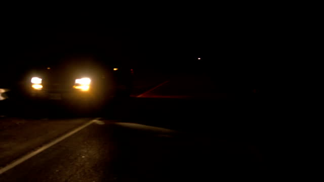 Car broken down on roadside at night with hazard lights When your SUV breaks down, drive to the shoulder with blinkers on and wait for emergency services. towing stock videos & royalty-free footage