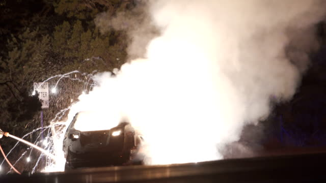 car burning by the highway: series - ribellione video stock e b–roll