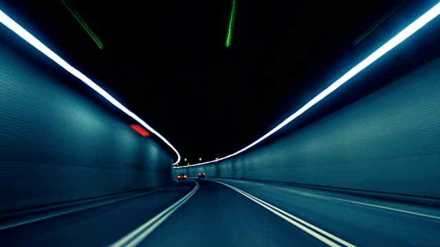 Car Dash Camera Time Lapse at Night in a Tunnel on the Highway
