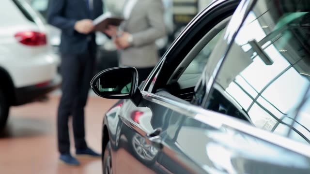 Car dealer and customer making a deal video