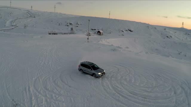 Car drifting on snow, aerial view video