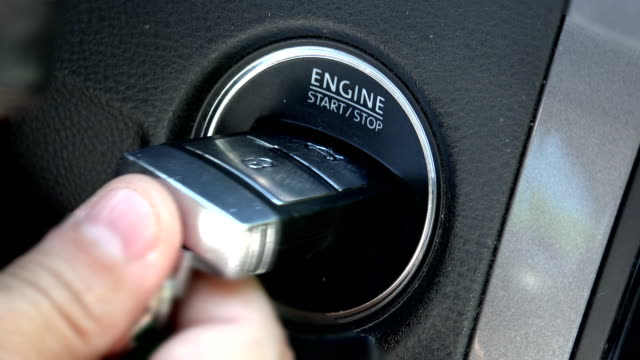 Car driver starting the engine with modern key video