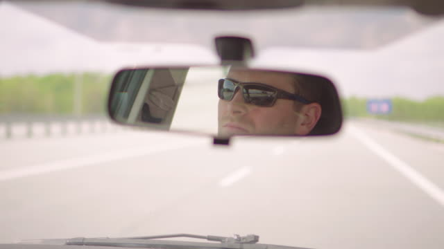 Car driver Car driver rear view mirror stock videos & royalty-free footage