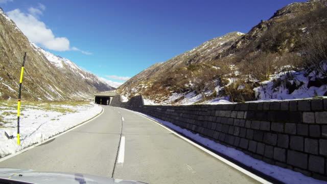 Car drives along mountain pass POV video