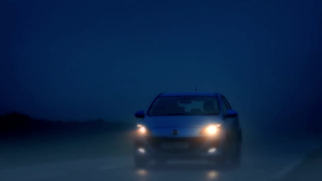 Car Drives On Foggy Road At Night video