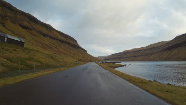 POV car driving at Faroe Islands: winter roads