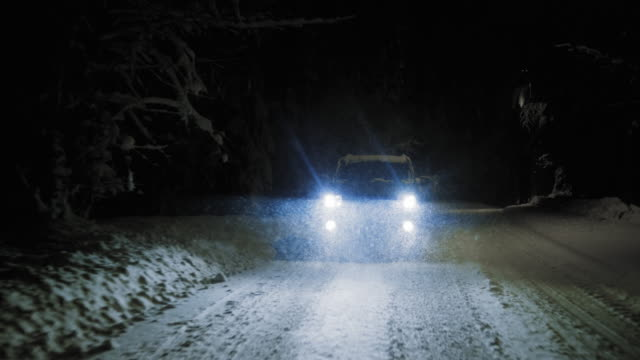 TS Car driving at night on snowy road in snowfall video