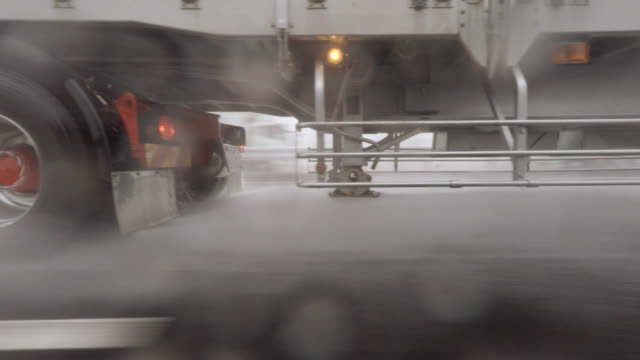 Car driving at rainy day - side view -4K video