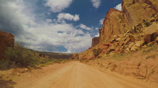 pov car driving in the canyon of usa - wiejska droga filmów i materiałów b-roll